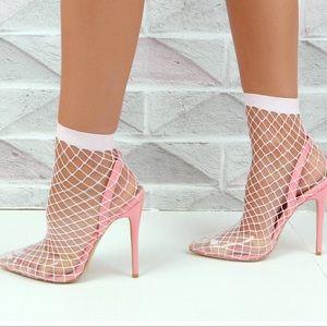 Fishnet Perspex pink heels